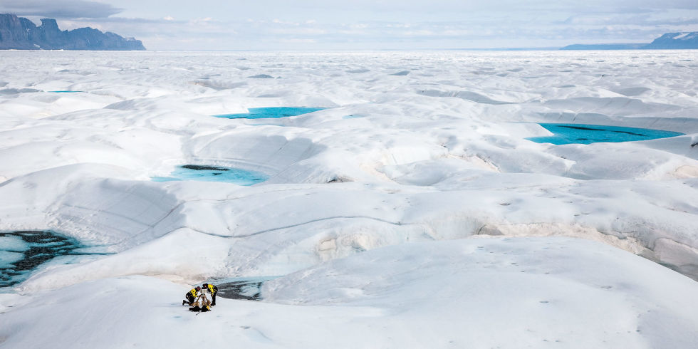 Glaciologist Jason Box, left, at work on the Petermann Glacier on Greenland's northwest coast, which has lost mass at an accelerated pace in recent years. Box and his family left Ohio State for Europe a couple years ago, and he is relieved to have escaped America's culture of climate-change denial.