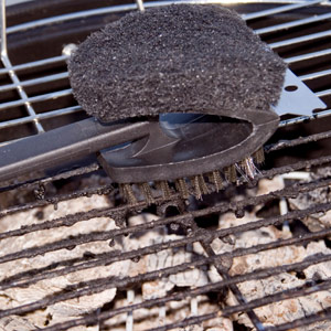 Always clean your grate immediately before and after cooking, using a long-handled stiff wire brush. In a pinch, you can scour the grate with a ball of crumpled aluminum foil held in tongs.