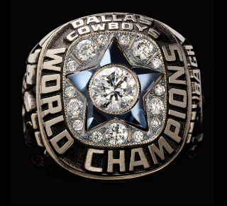 The Cowboys have the simplest, most recognizable logo in the league, and their first title ring highlights it beautifully.