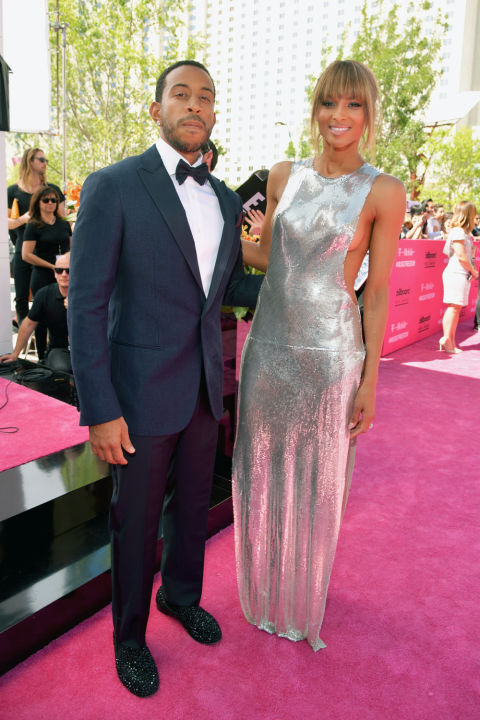 """In a sea of """"creative black tie"""" and what can only be described as """"not even close to black tie,"""" it's nice to see Ludacris go all-in with a classic tux that fits him well. Having Ciara as a co-host doesn't hurt, either."""