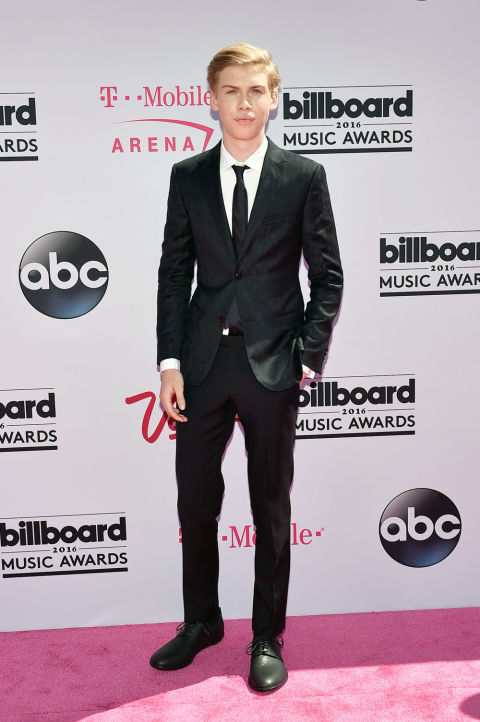 If you're looking for the right way to wear a slim, black suit, here it is. The fit is on point, and the rest of the look—white shirt, black tie, black shoes—is appropriately classic and understated.